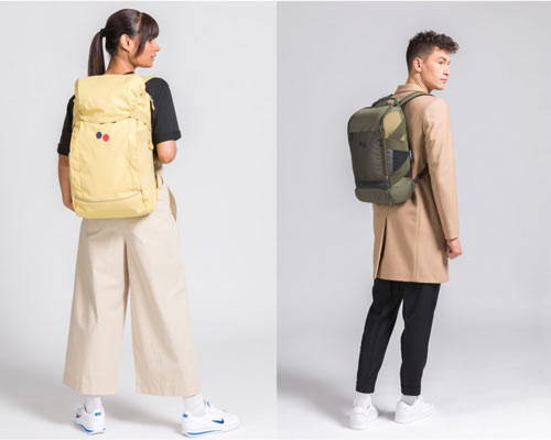 Woman wearing recycled polyester pinqponq backpack in yellow and man wearing recycled polyester sustainable backpack in khaki
