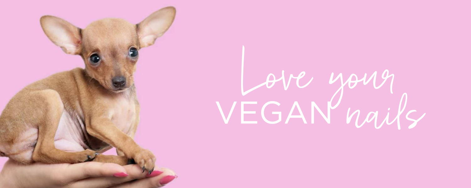 ORLY manicured hand holding cute puppy with the words 'love your vegan nails'
