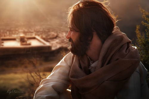 Photo of Jesus sitting on a hill looking down at Jerusalem.