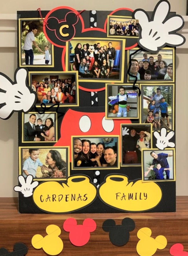 Family board made by the cardenas family with mickey mouse and lots of family pictures!
