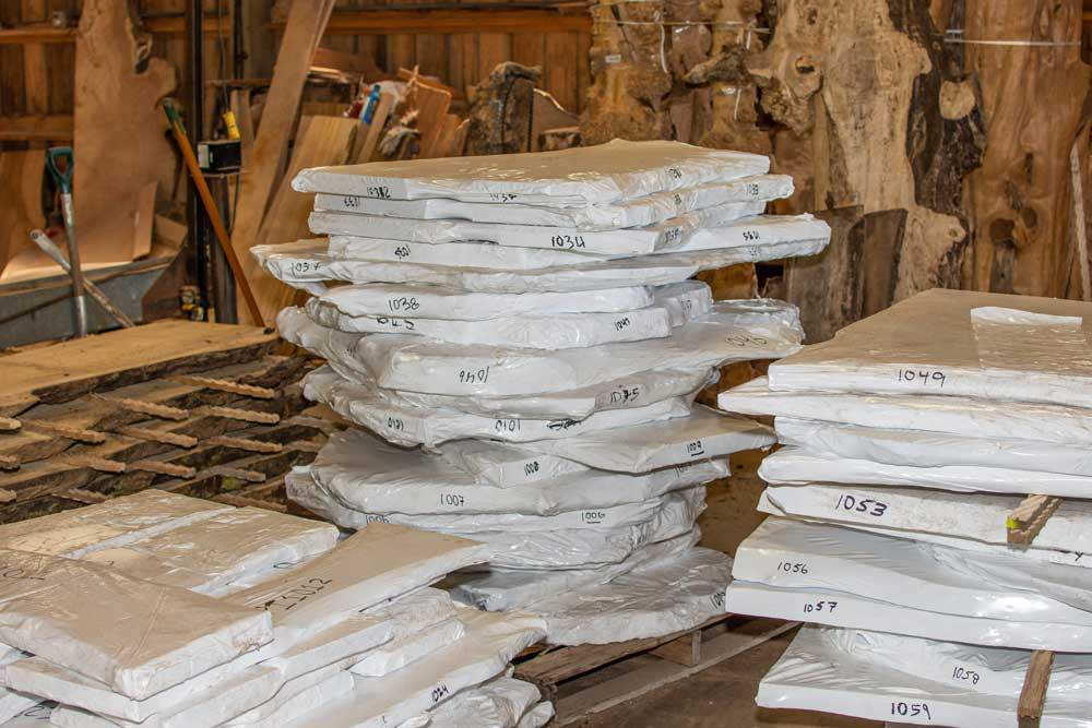 Finished and dried wood slabs ready to be shipped out for your next woodworking project