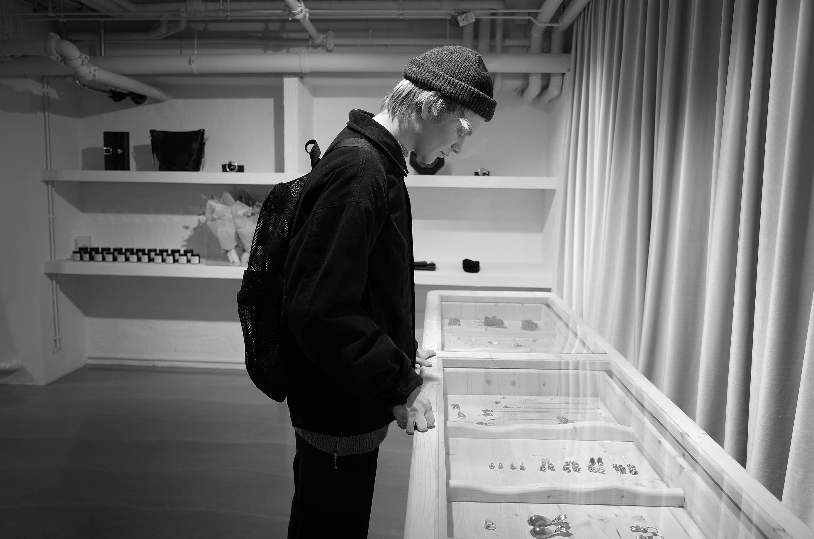 Image - A man looking at some items in a display-case