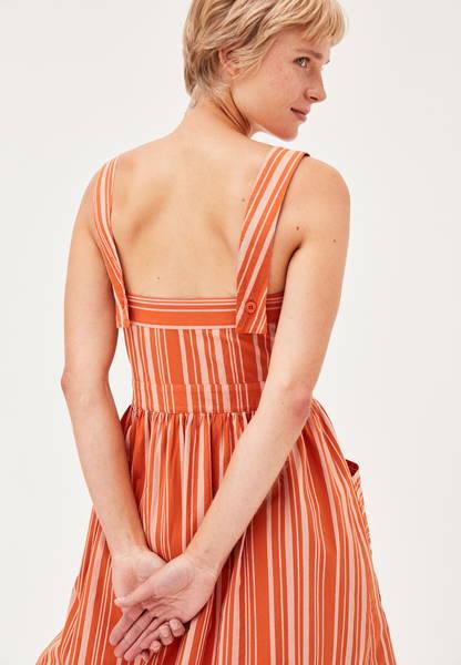 Back of women's striped organic cotton dress in Orange