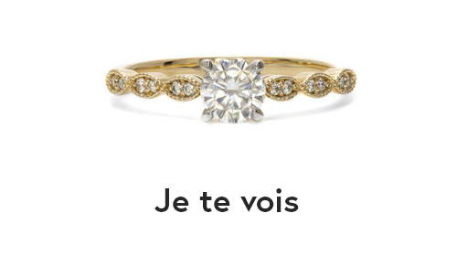 Semi-eternity ring in yellow gold with a large diamond in the center