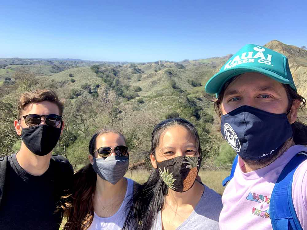 Four friends posing for a selfie in face masks at Lovers Loop in Los Olivos Santa Ynez Valley