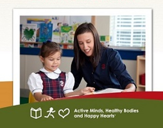We're hiring poster featuring a Primrose teacher helping a young student read