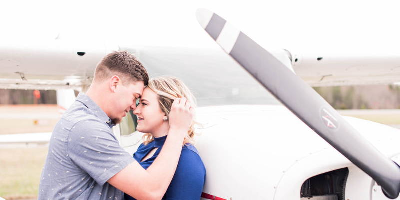 Sweet Christmas surprise captured during airport engagement session