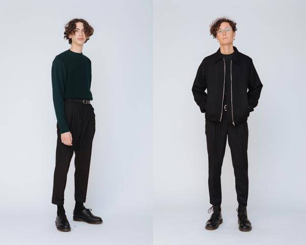 Man wearing black wool jacket and black skinny trousers from sustainable fashion brand Hund Hund and man wearing dark green long sleeve t-shirt and man wearing cropped black trousers with black derby shoes