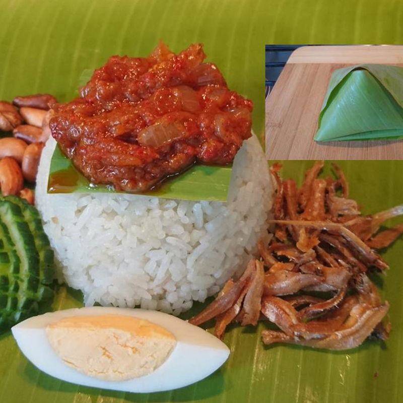 """Date: 20 Jan 2020 (Mon) 8th Breakfast: Nasi Lemak Daun Pisang (Nasi Lemak in Banana Leaf) [189] [138.7%] [Score: 9.8] Cuisine: Malaysian, Singaporean Dish Type: Main Here the nasi lemak is presented in its barest minimum, wrapped with only one piece of banana leaf. All the banana leaves I bought 3 months ago in the freezer have completely disintegrated. The nasi lemak should be wrapped with newspaper lined with banana leaf. I do not have newspaper and to buy one is """"expensive"""", AUD3.50. Not worth the money. I do not read newspaper and I certainly do not eat it. There was however, one loose piece of banana leaf around. So, as said in this presentation, the nasi lemak was only wrapped with that piece of banana leaf. Happy that the dish scored a 9.8 :).  Simplicity is the hallmark of a genius. The genius hallmark goes to Nyonya Cooking again!"""