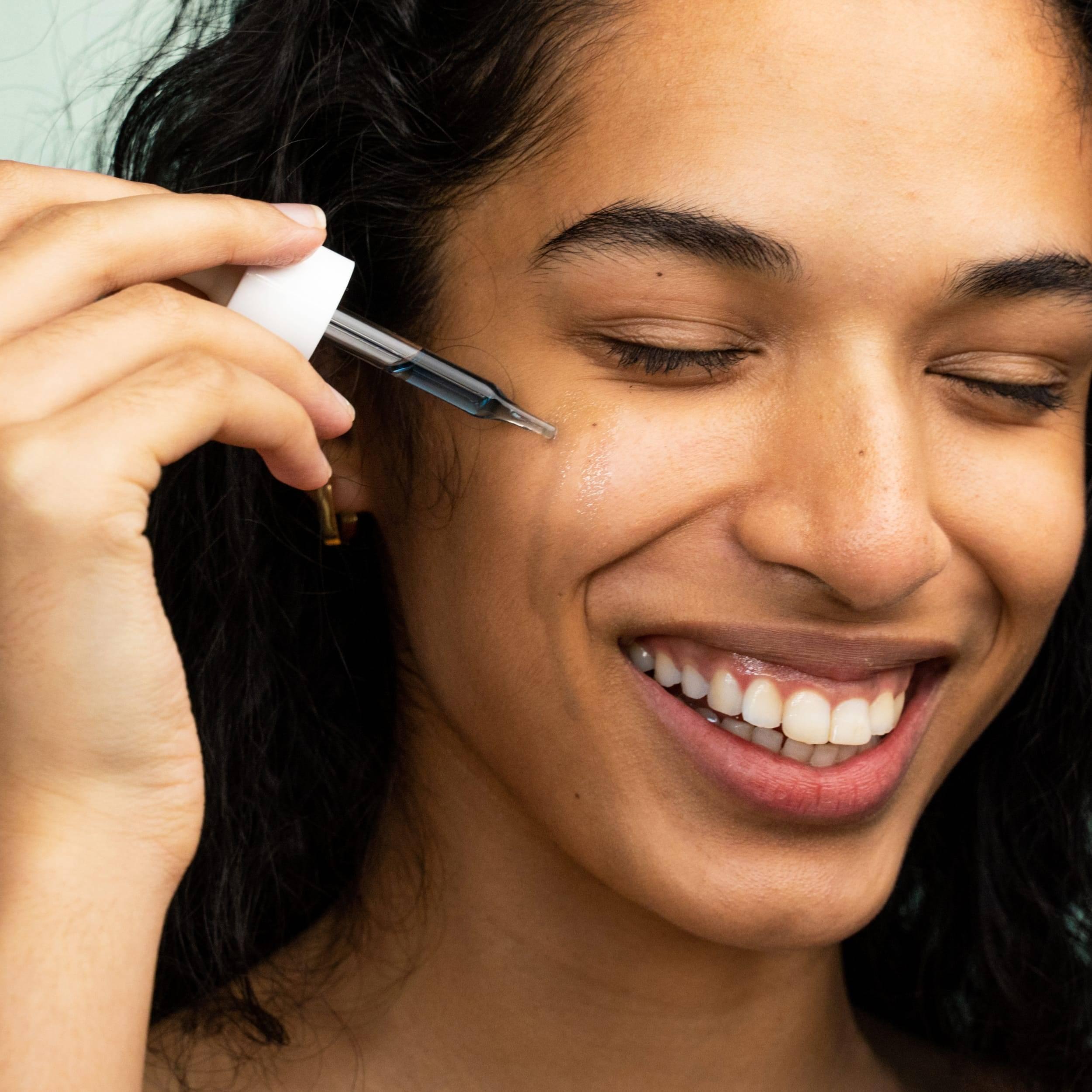 Model using Blue Tansy Facial Oil