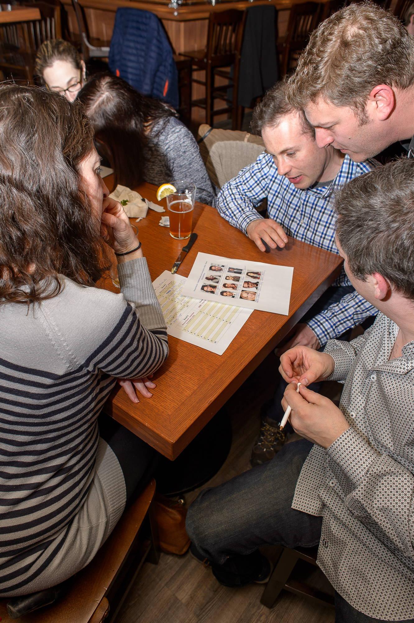 People enjoying a trivia night at a pub