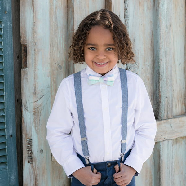 child with boys belts, suspenders & ties