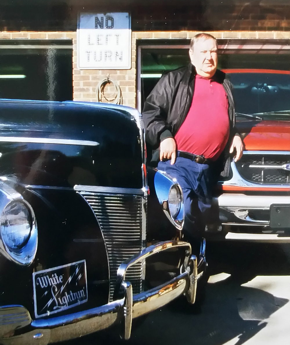 "Willie Clay Call, with one of his ""White Lightnin"" 1940 Fords"