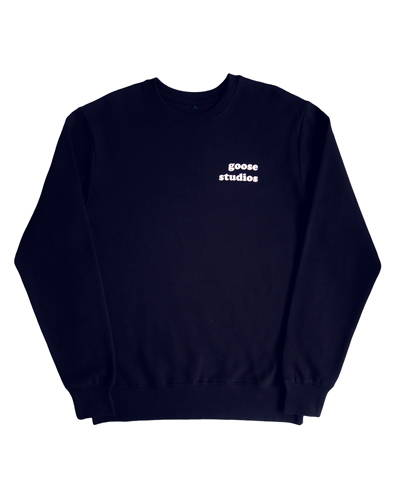 Front of navy womens organic cotton sweatshirt with white Goose Studios logo on left chest