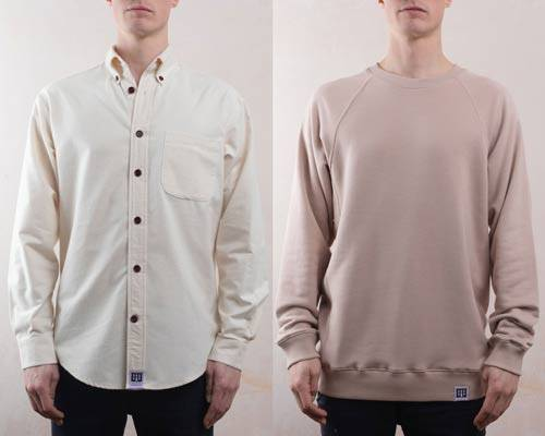Man wearing organic cotton sustainable button down cream shirt with brown corzo buttons next to man wearing soft pink organic cotton relaxed fit sweatshirt both from menswear brand Lyme Terrace