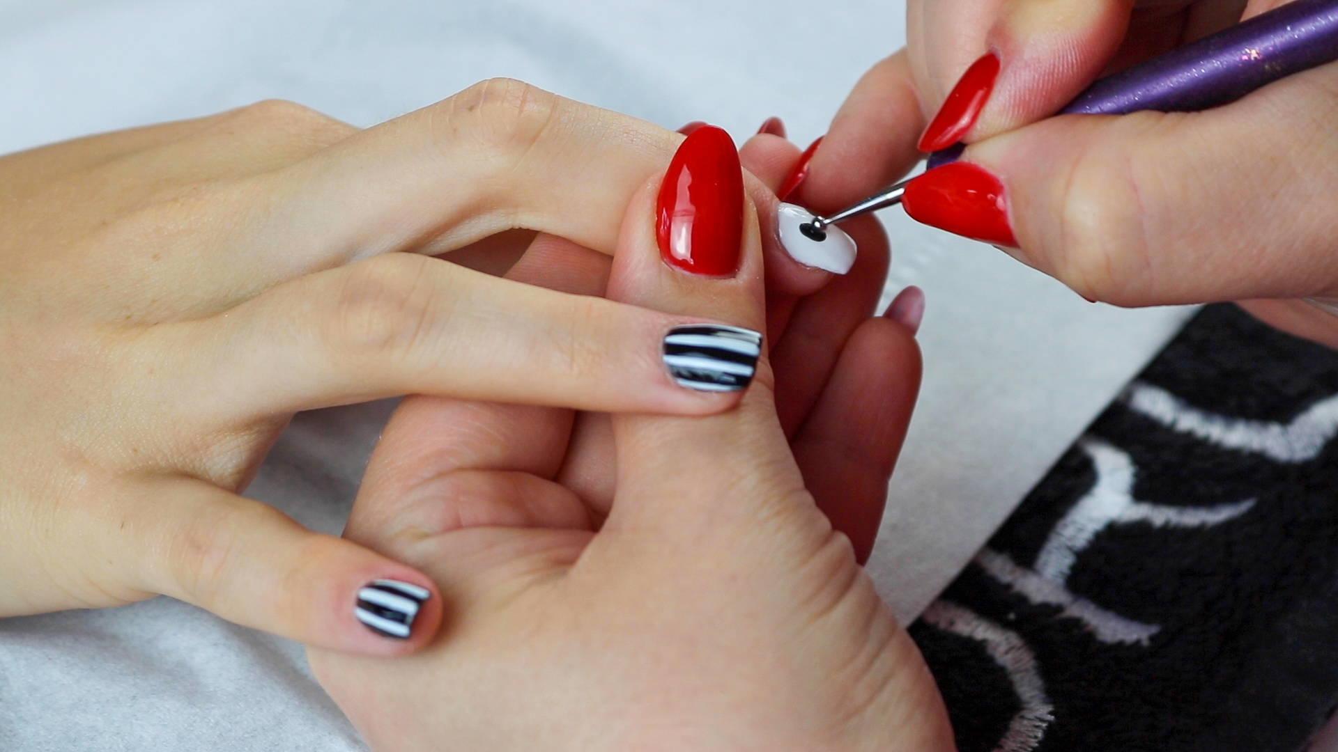 Jack Skellington nails eye detailing being added to nails using ORLY Liquid Vinyl