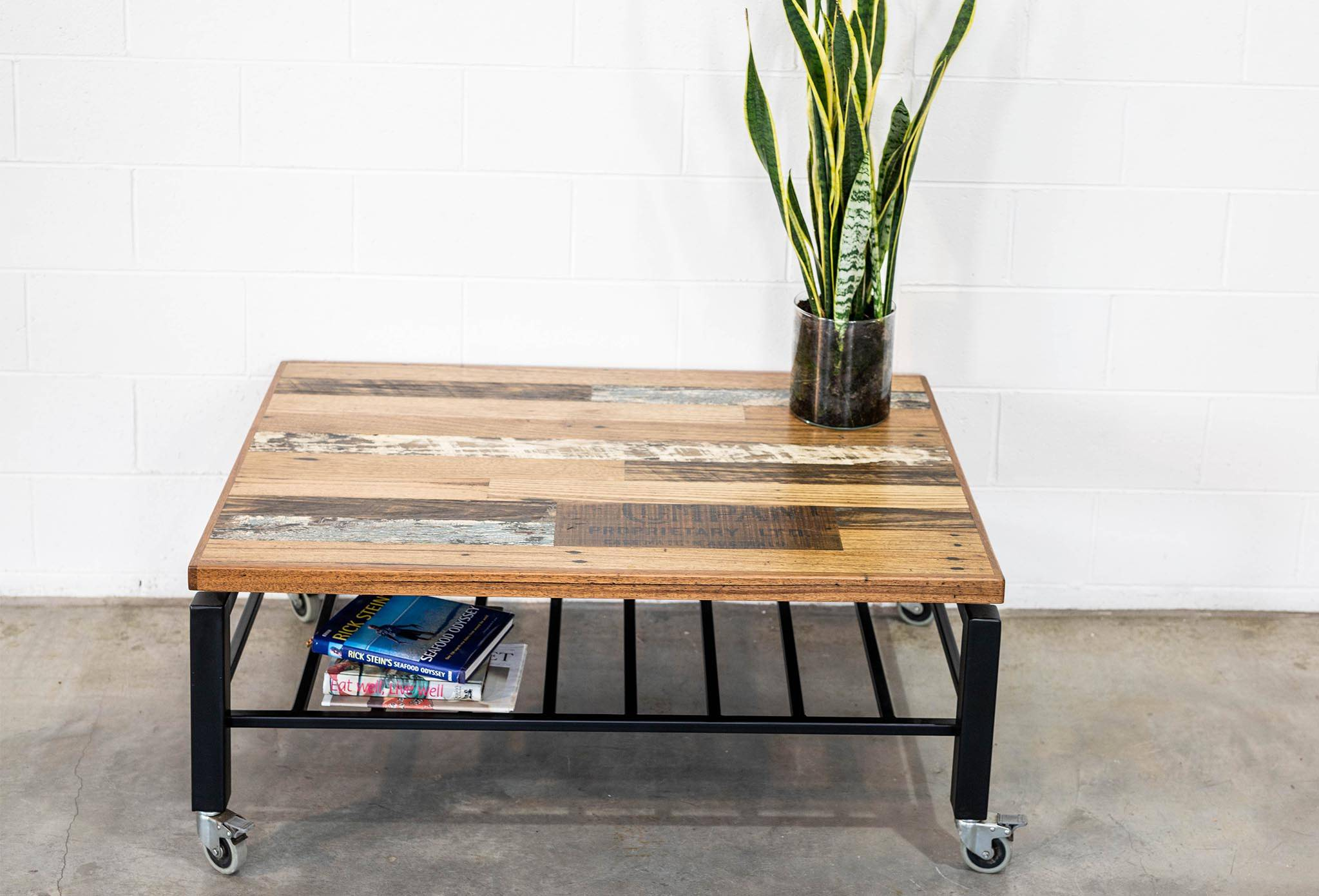 Coffee Table Scatter Top w/ Colours and Inlay. Black Steel Frame with castors and magazine rack