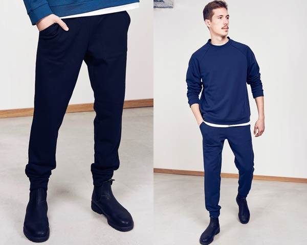 Man wearing dark navy sustainable organic trousers and man wearing navy matching sweatpants and sweatpants