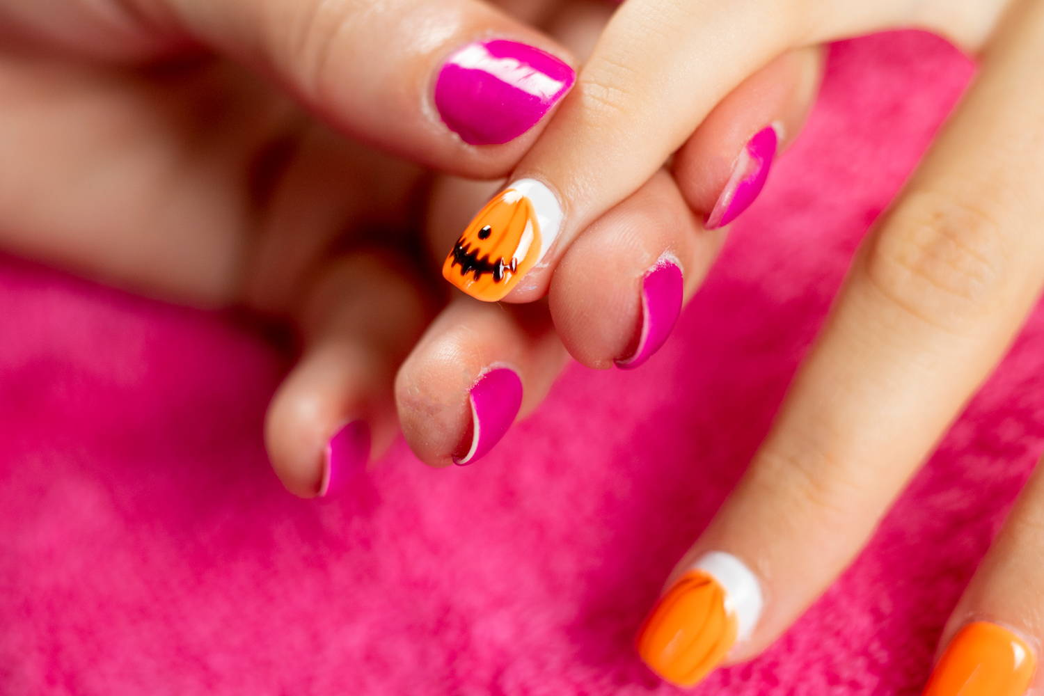 Pumpkin nails detailing added to nail using a dotting tool and ORLY Liquid Vinyl
