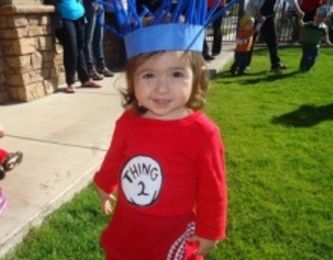 Little girl dresses as a character from a Dr. Seuss book to celebrate his birthday and read across America day