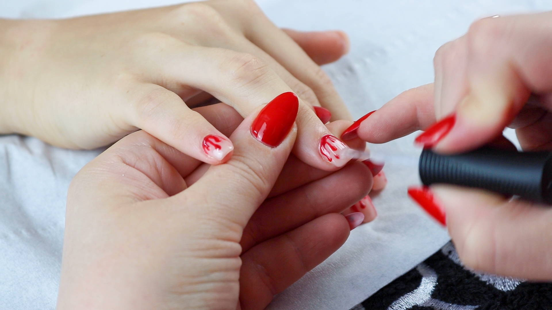 ORLY Glosser Topcoat being painted on finished blood nails