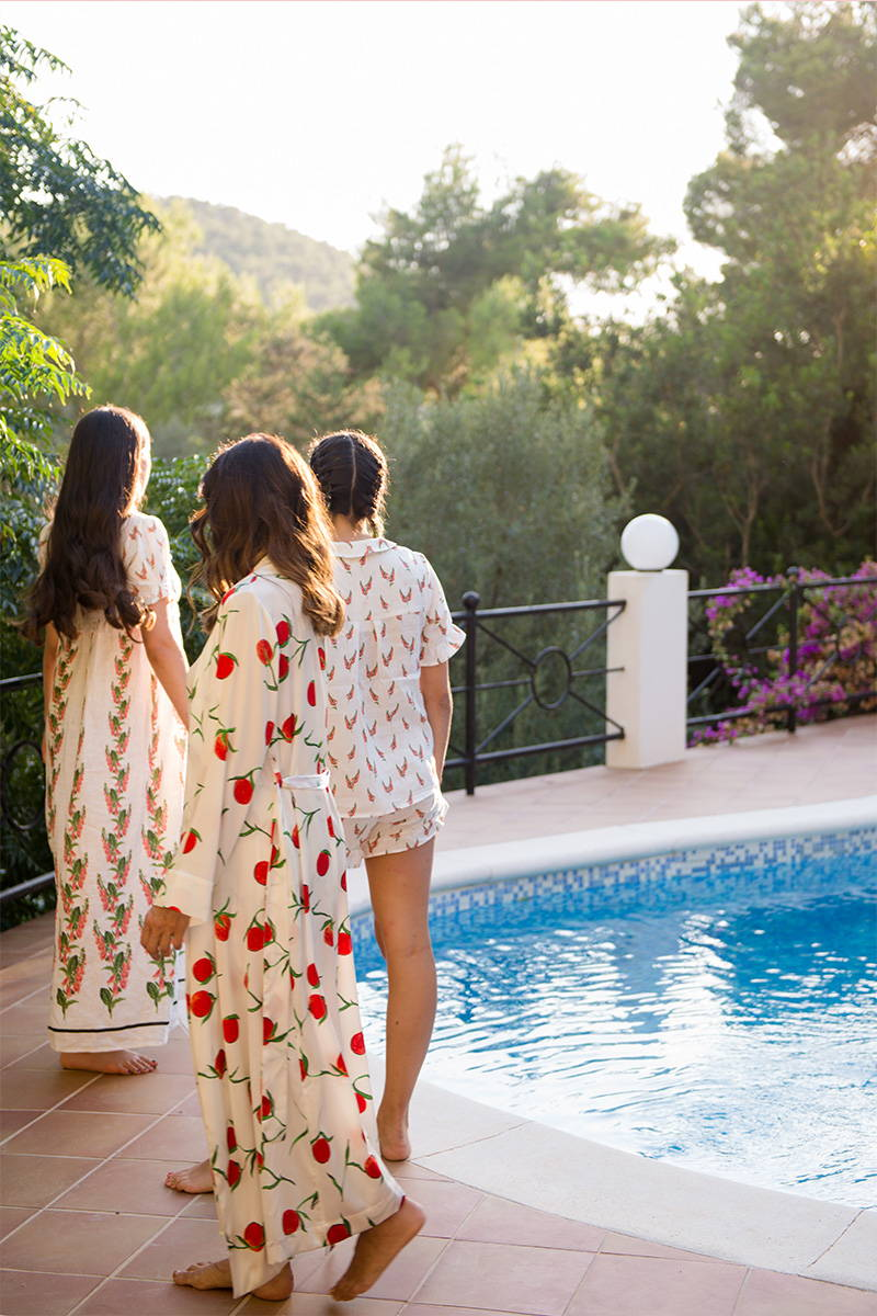 Yasmin Mills and Daughters stroll around their pool wearing YOLKE