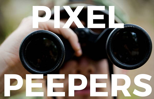 A man was using a telescope. There is Pixel Peeper typed on his face