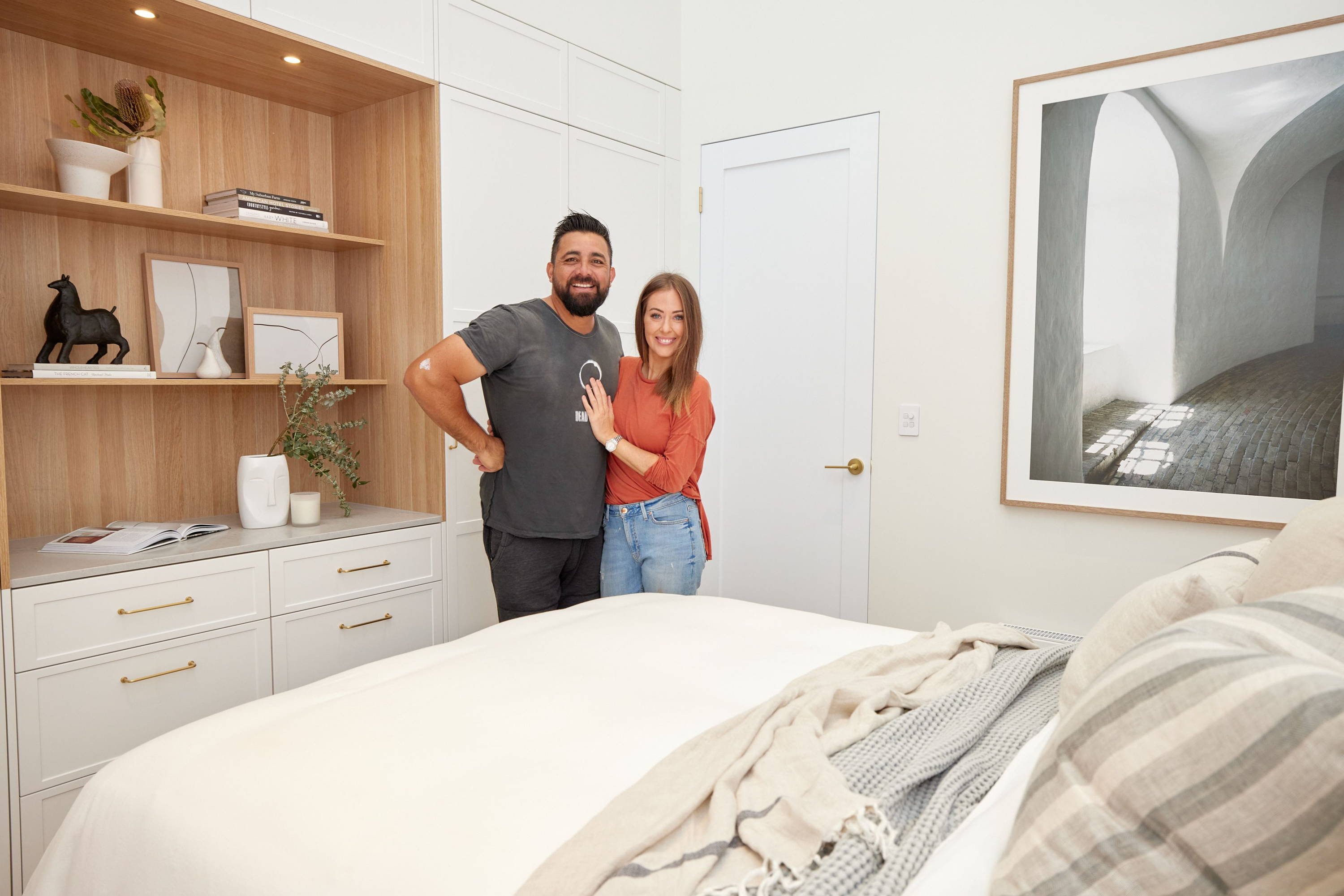 Ronnie and Georgia on The Block in their Guest Bedroom - A neutral bedroom interior with the two contestants in situ