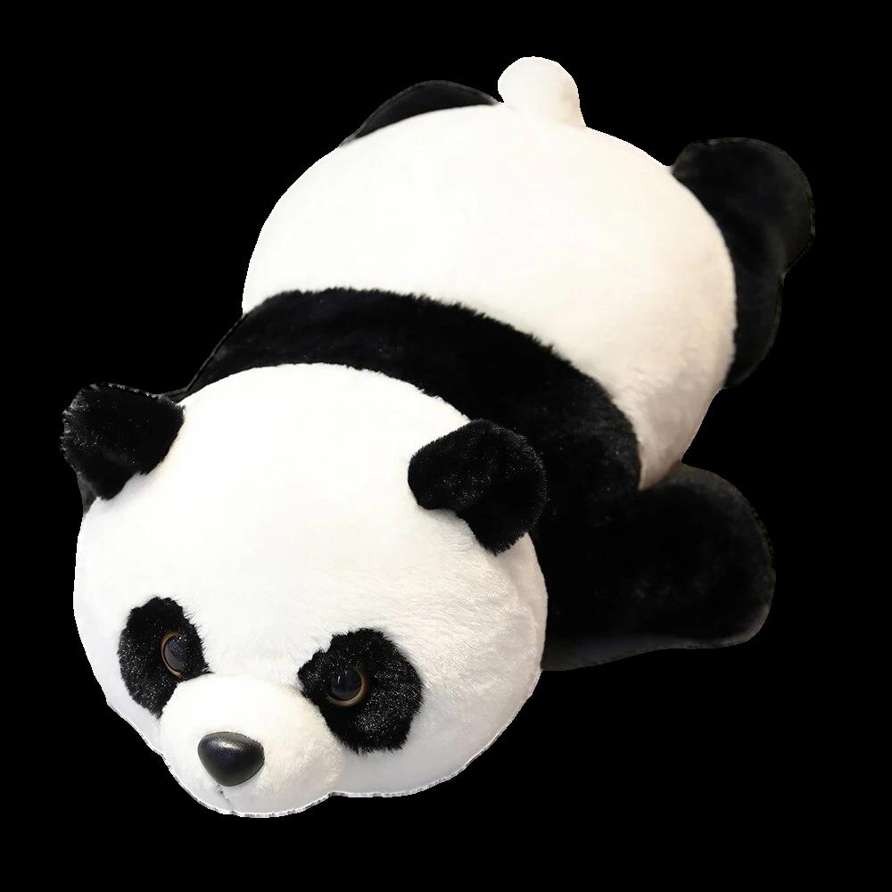 peluche panda allonge sur le vert