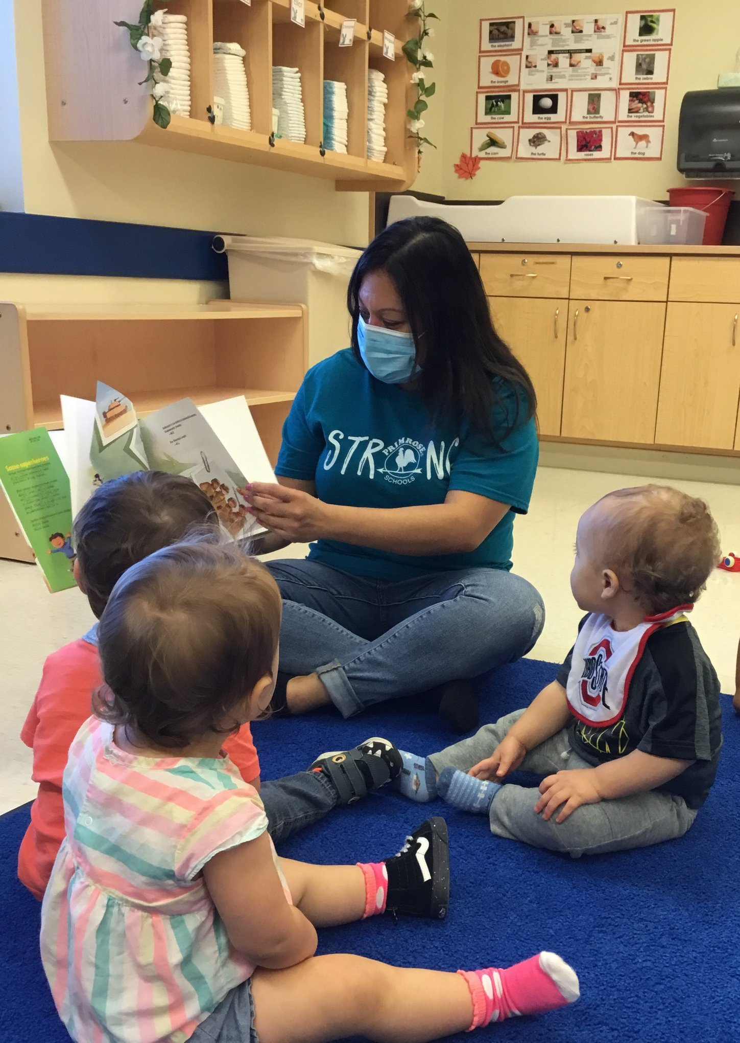 Veterans, Veteran's Day, Teacher Reading Book to Infants, Infant Care, Child care, daycare, Clear Lake, 77062