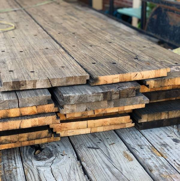 Stacked oak butcher block planks in a truck bed