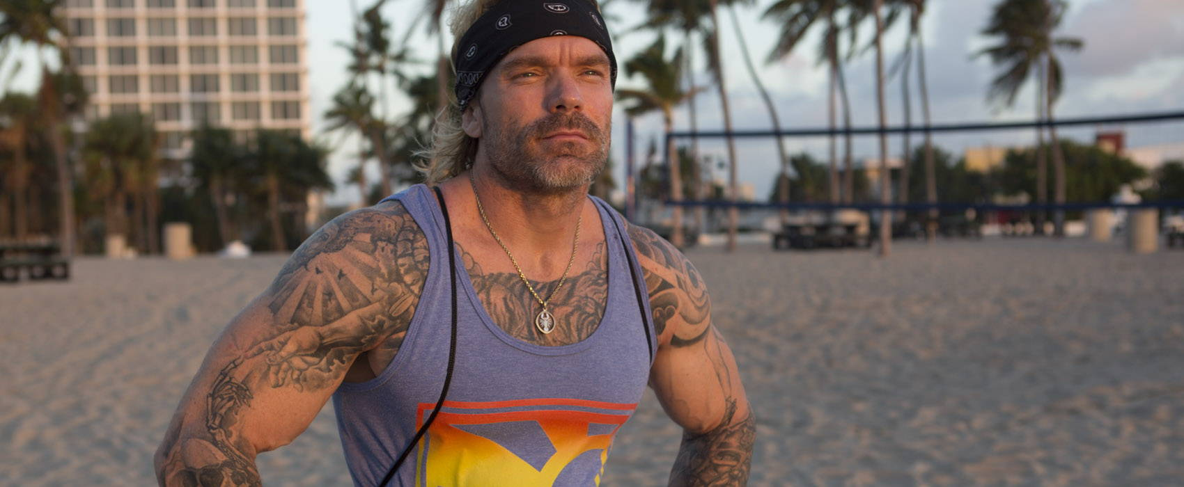 Resistance Bands workout on beach with fitness expert James Grage