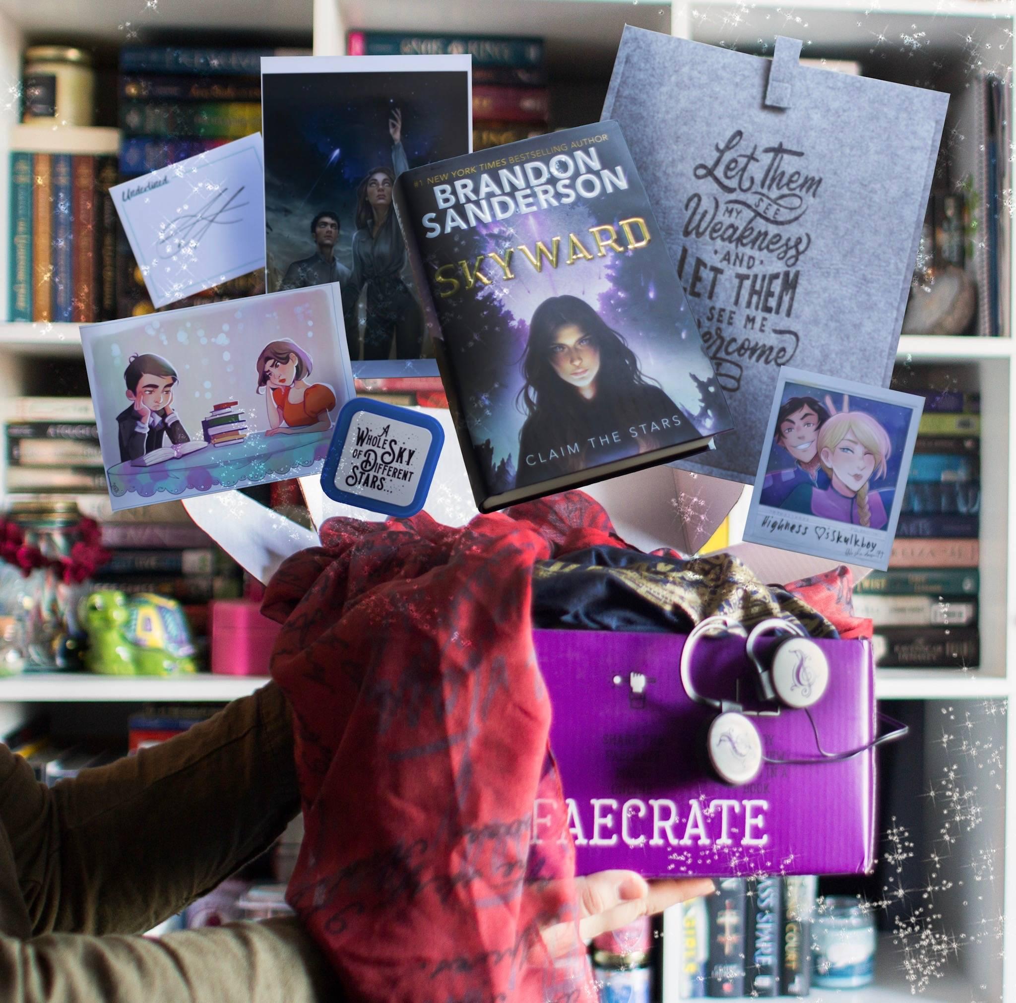November 2018 Stargazers box theme included Mistborn Felt Booksleeve, Skyward by Brandon Sanderson, Mistborn Vin & Elend Art, Skyward Art Print and Vertical Pillow Case, Skyward Pilot's Pin, The Queen's Rising Headphones, The Wrath and Dawn Scarf, Illuminae Collectors Polaroid, Illuminae Night Light, Strange the Dreamer Shirt included in Seelie and Solitary Fae boxes only.