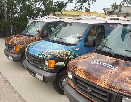 Image of Comcast trucks with new graphics