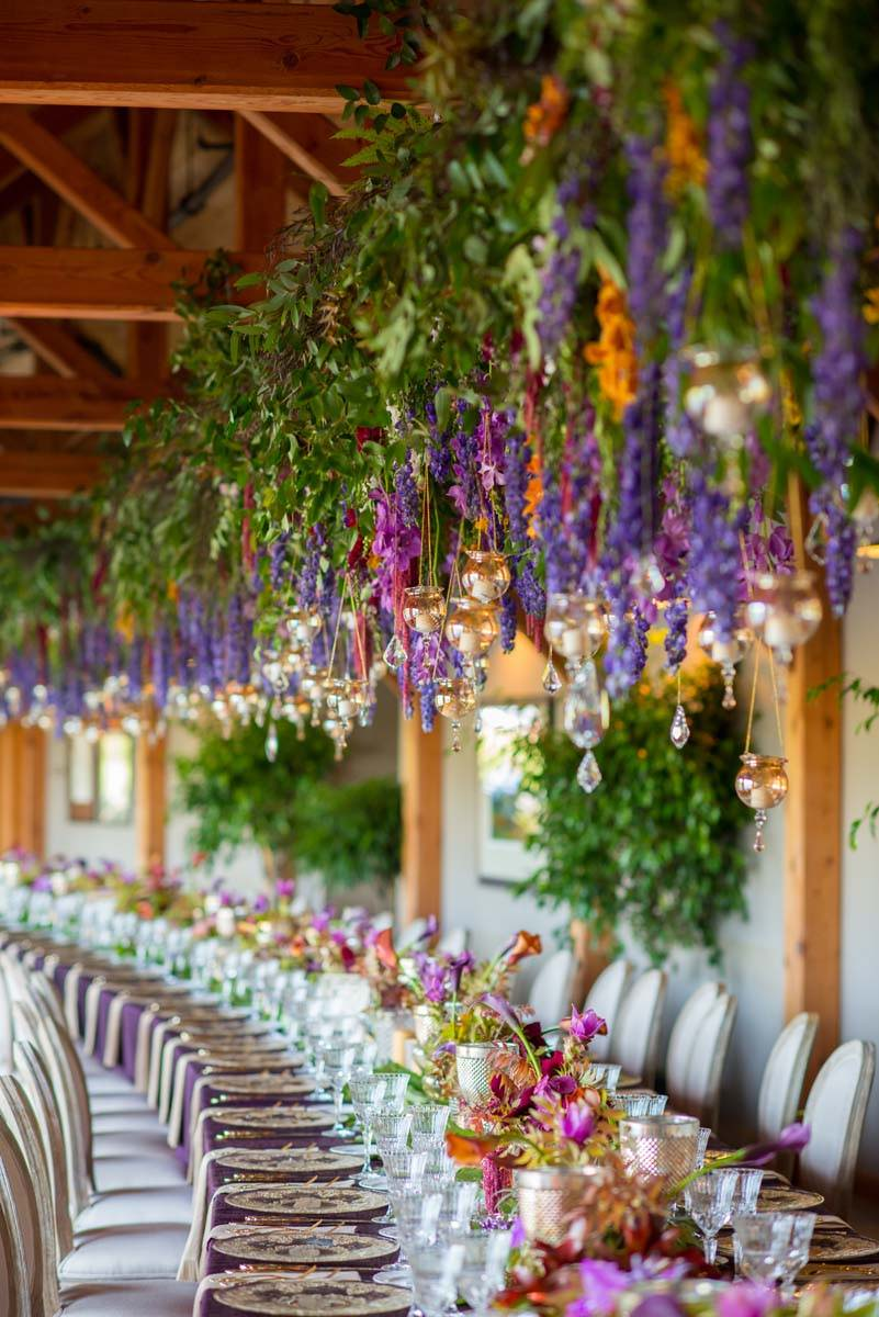 Welch Allyn Lodge wedding with very long curved table | Purple and orange wedding | Wedding Trees