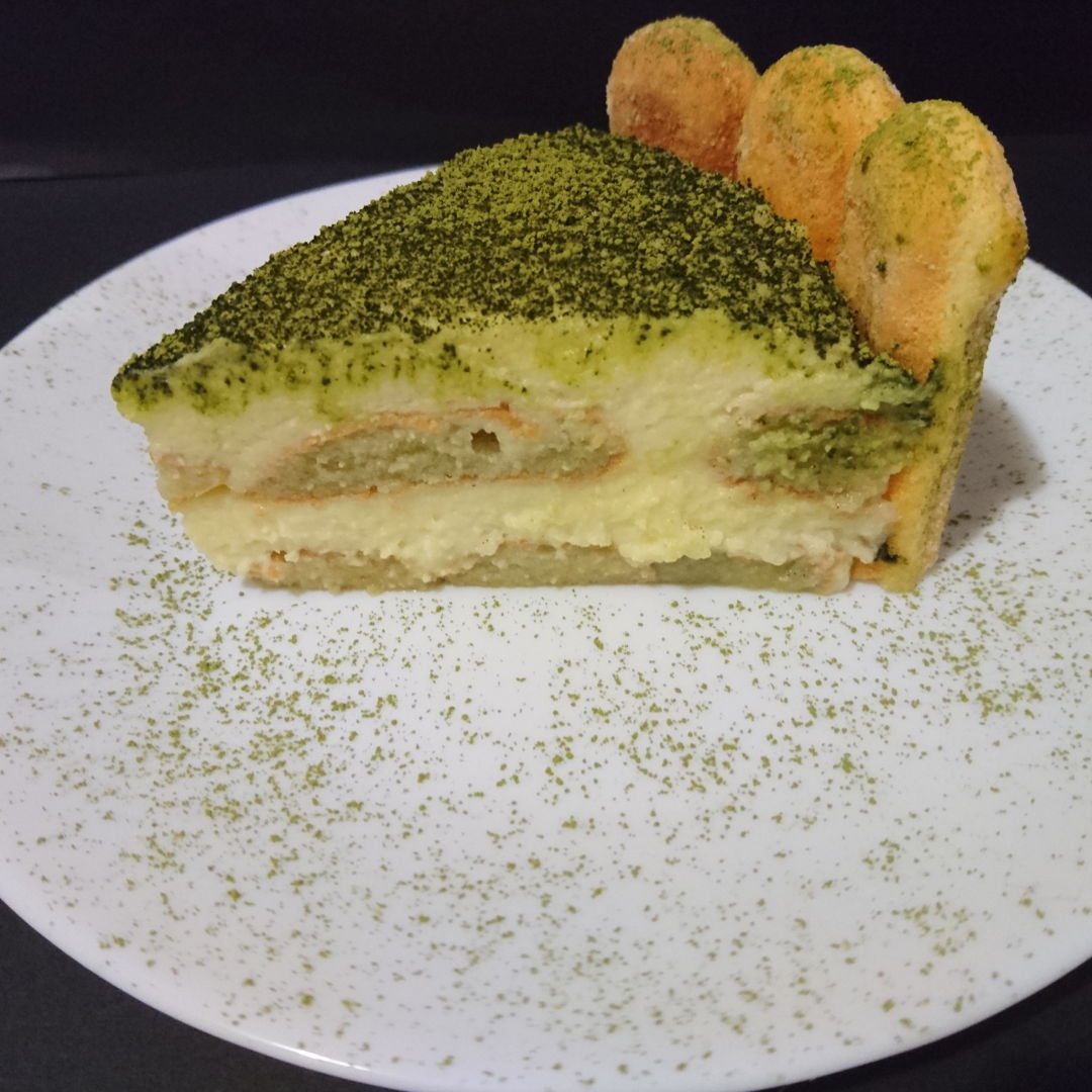 Date: 6 Dec 2019 (Fri) 1/8 of Matcha Tiramisu Cake on a plate with sprinkles of matcha powder.