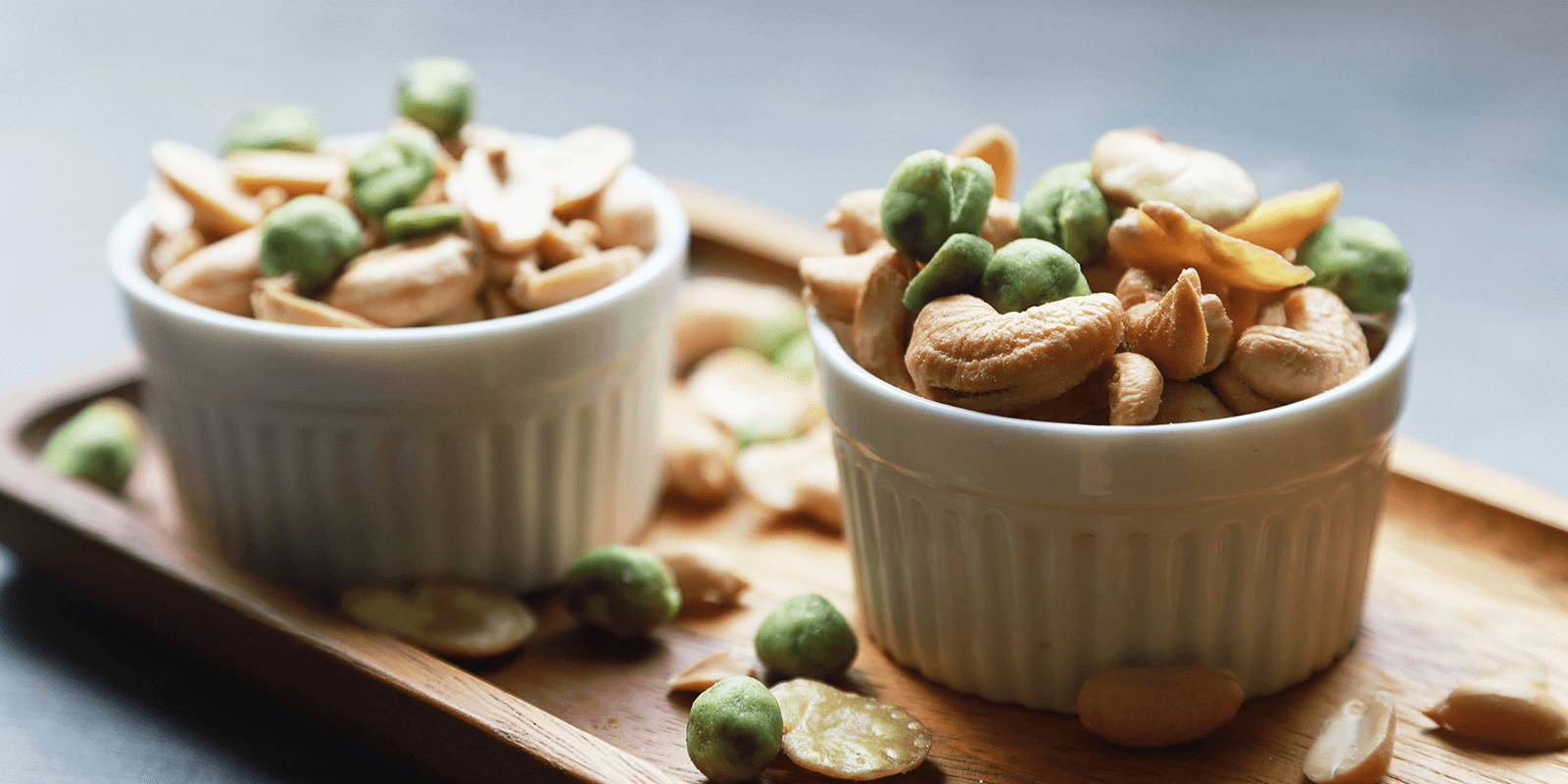 Two bowls of mixed nuts.