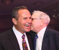 Ron Carson keeps his friends close and his fellow alpha dogs --Warren Buffet, right -- closer.