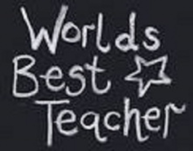 "Close up of the words ""World's best teacher"" written on a chalkboard"