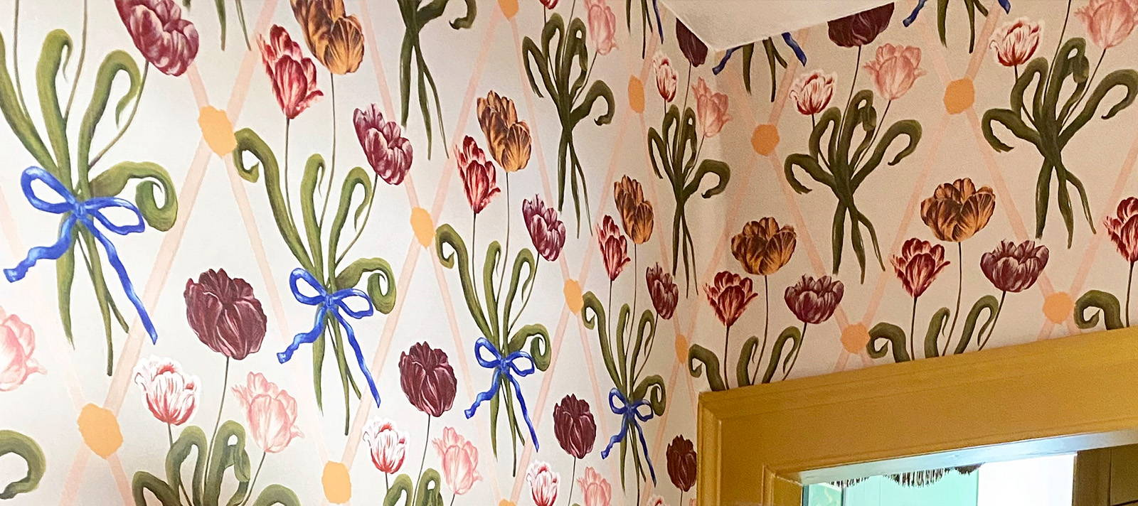 A close up of Polly Fern's wall paper featuring bows and flowers