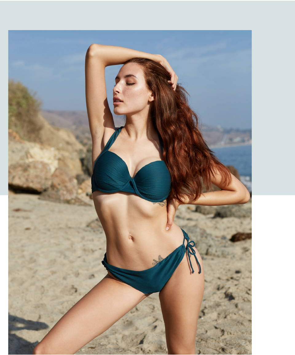 Aly Rae is wearing SKYE's Scarlett top and Juliana bottom in the Bliss Green color from the GEMS collection.