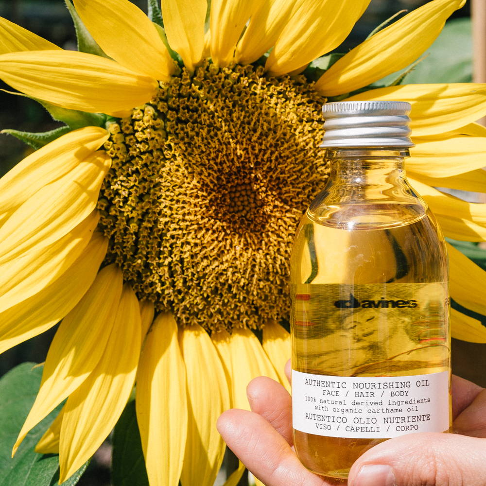 image of a Davines product with a sunflower