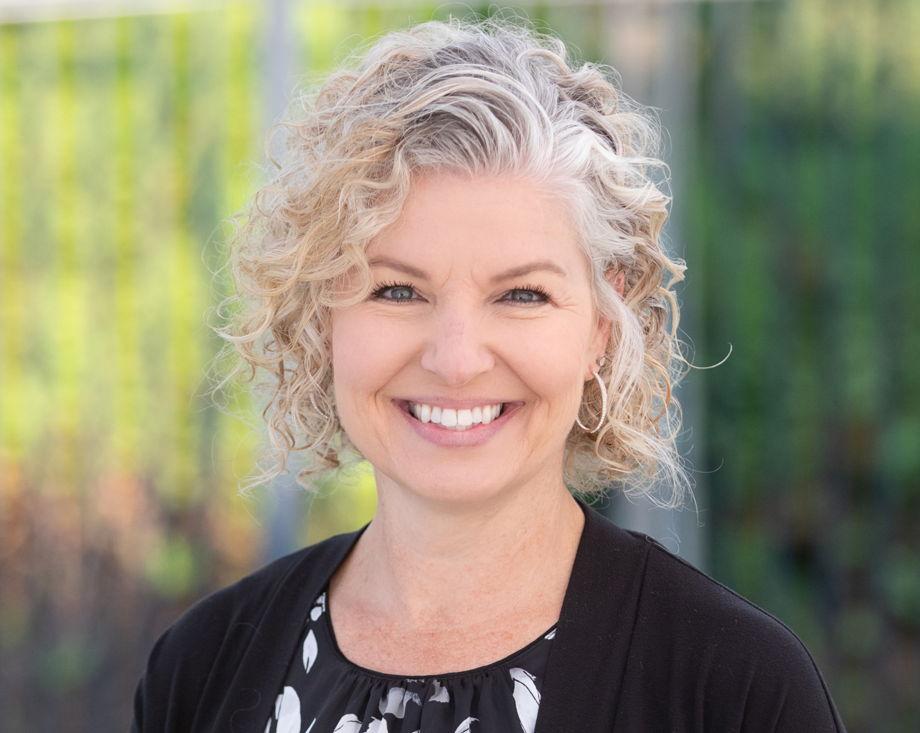 Amber Tooley , Director