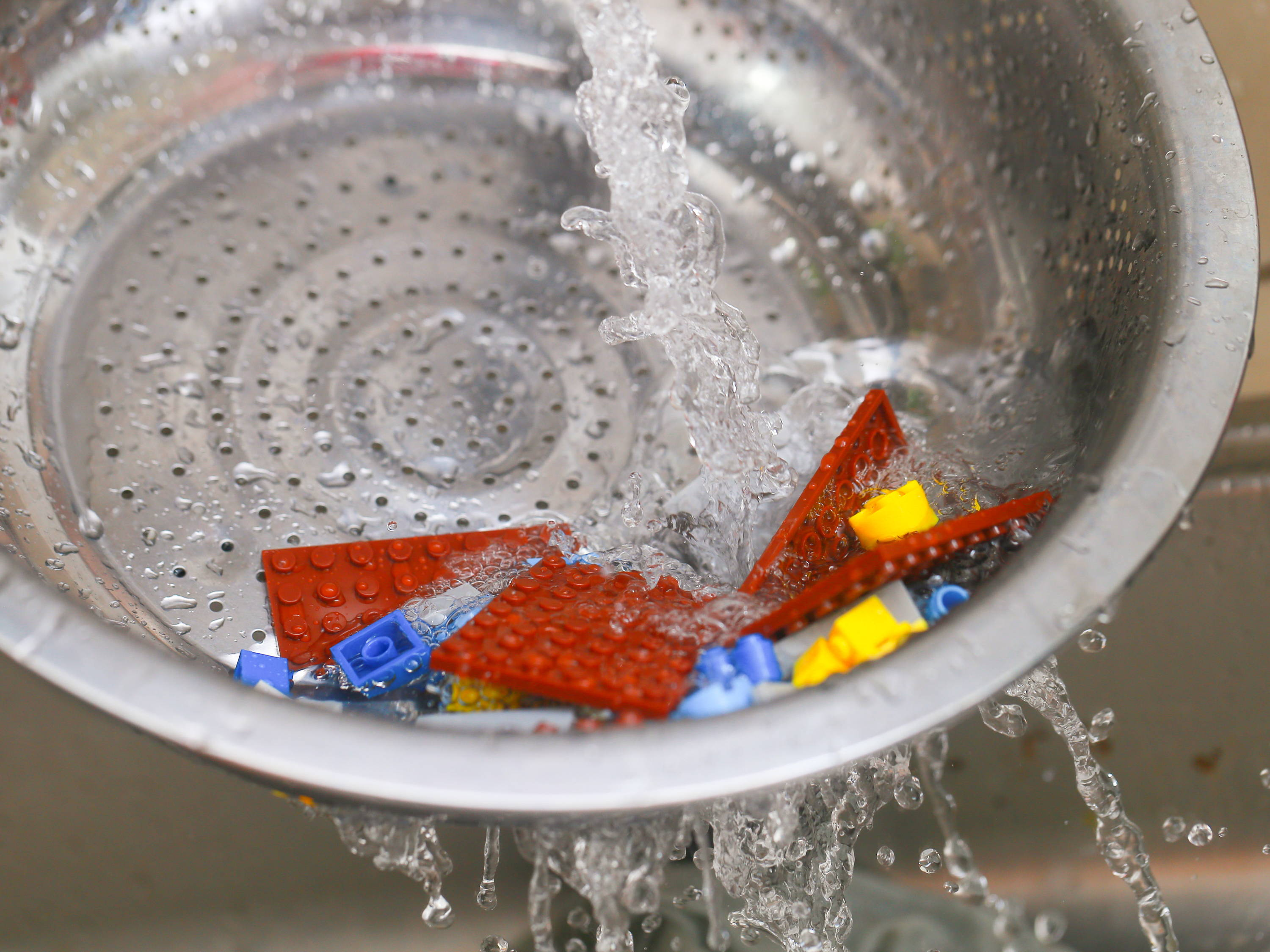 clean lego set with water
