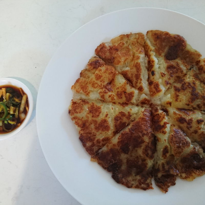 Date: 21 Oct 2019 (Mon) 5th Snacks: Gamjajeon - 감자전 (Potato pancake): [74] [100.0%] [Score: 8.0] Author: Maangchi Cuisine: Korean Dish Type: Snack  The inside of Gamjajeon: 감자전 is chewy and soft, and the outside is a little crispy and crunchy like a french fry. The grated onion totally makes it: onion and potato is a good combination! If you have a potato, just grate and make and serve with a glass of milk! It's also much better with the sauce, which is optional, but highly recommended.