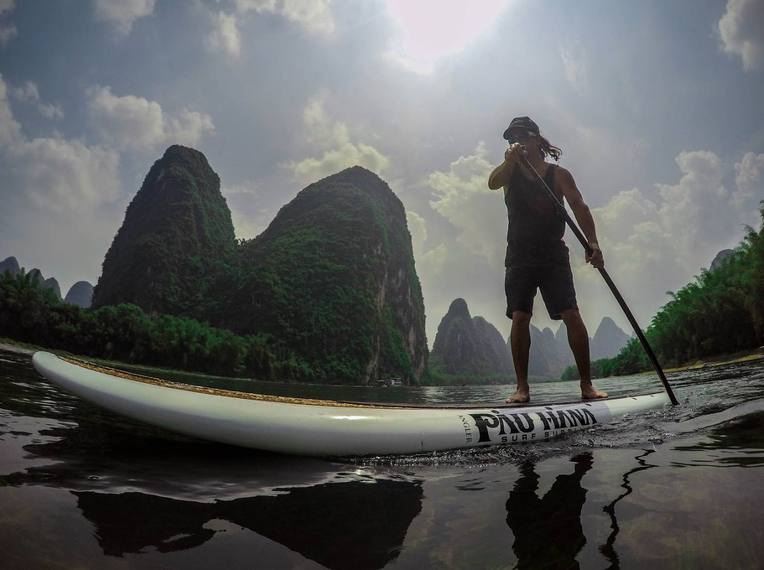 Todd on his angler sup on the river in china