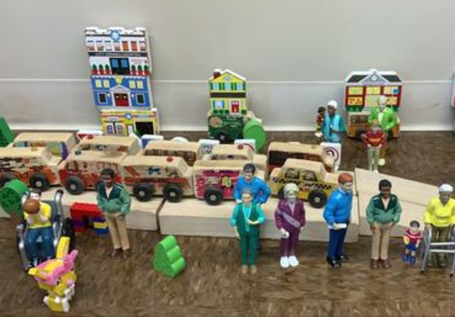 human and car toys set up in a movie set that the students use to film their stop-motion movie