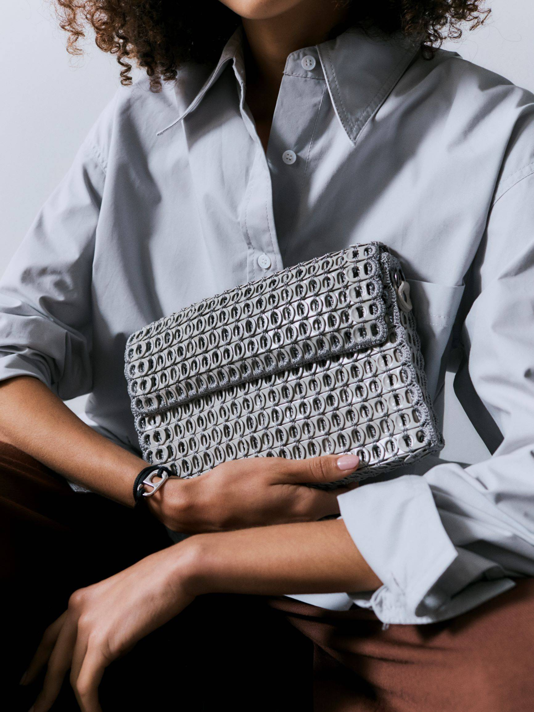 A BOTTLETOP bag made from recycled aluminium ring pulls