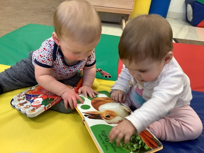 Today at our Lakewood Ranch Town Center campus, our Infants are exploring books together.