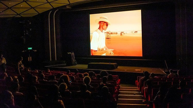 An audience watching a film screening.
